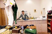 MAY 15, 2014 - KOJIMA, KURASHIKI, JAPAN: A shop owner works at a shop at Jeans Street.  (Photograph / Ko Sasaki)