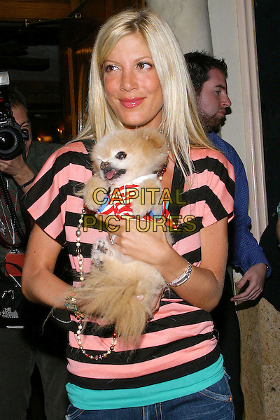 TORI SPELLING & MR WINKLE.during Much Love Animal Rescue Celebrity Comedy Benefit at the Laugh Factory,West Hollywood, CA, USA, 29th September 2004..half length striped pink and black top beads necklaces dog.Ref: ADM.www.capitalpictures.com.sales@capitalpictures.com.©V.S/AdMedia/Capital Pictures.