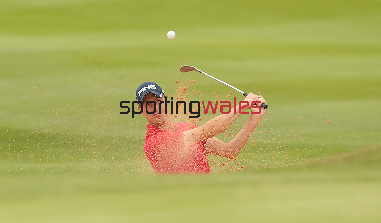 Welsh golfer Rhys Davies plays plays out of the sand on the first hole during the opening round of the ISPS Handa Wales Open 2013 at the Celtic Manor Resort<br /> <br /> 29.08.13<br /> <br /> ©Steve Pope-Sportingwales