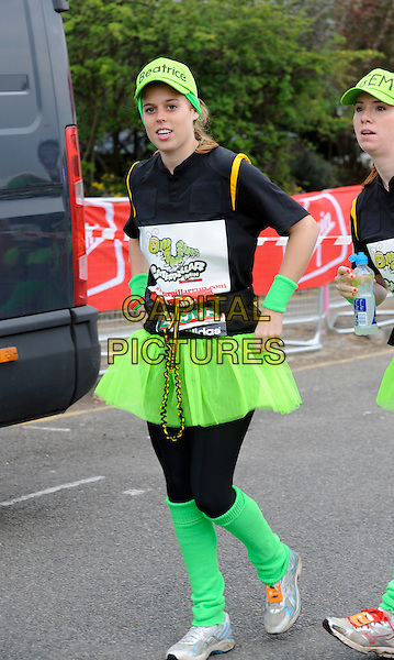 HRH PRINCESS BEATRICE .Celebrities take part in the Virgin London Marathon 2010, London, England, UK, 25th April 2010..full  length black leggings green leg warmers tutu royal  cap hat name  top wrist trainers caterpillar costume .CAP/DH.©David Hitchens/Capital Pictures.