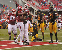 NWA Democrat-Gazette/MICHAEL WOODS • Arkansas running back Alex Collins celebrates with Dominique Reed after scoring a touchdown in the 2nd quarter of Friday's game at Razorback Stadium November 27, 2015.