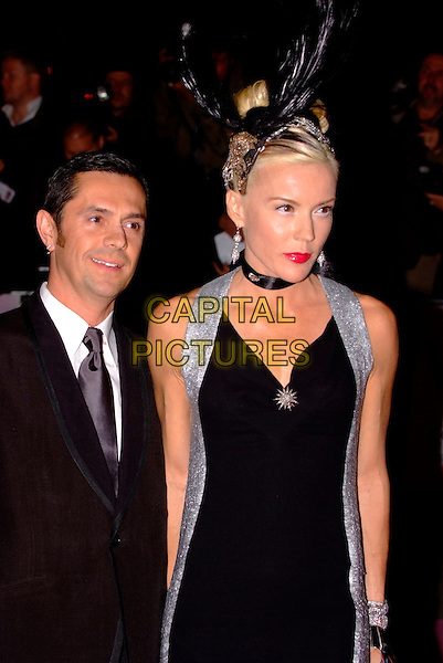 DAPHNE GUINNESS & GUEST.The Golden Age of Couture VIP Gala held at the Victoria and Albert Museum, Kensington, London, England. .September 18th, 2007 .V&A V & A half length feather hat head piece black dress silver red lipstick .CAP/SW.©Stephen Walters/Capital Pictures.