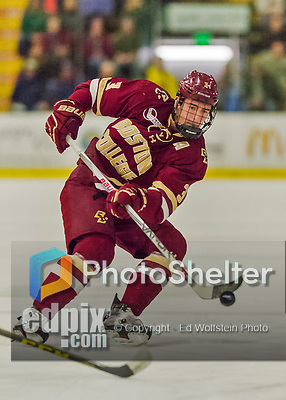 20 February 2016: Boston College Eagle Defenseman Ian McCoshen, a Junior from Faribault, MN, controls the puck during the first period against the University of Vermont Catamounts at Gutterson Fieldhouse in Burlington, Vermont. The Eagles defeated the Catamounts 4-1 in the second game of their weekend series. Mandatory Credit: Ed Wolfstein Photo *** RAW (NEF) Image File Available ***