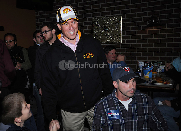 Rick Santorum hosts an Insight Bowl Watch Party at Okoboji Grill in Johnston, Iowa while campaigning for the Iowa Caucuses. December 30, 2011.© mpi01/MediaPunch Inc.