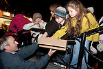 Niall Kierans distributing sugary treats at the switching on of the Christmas lights on West Street, last Friday.