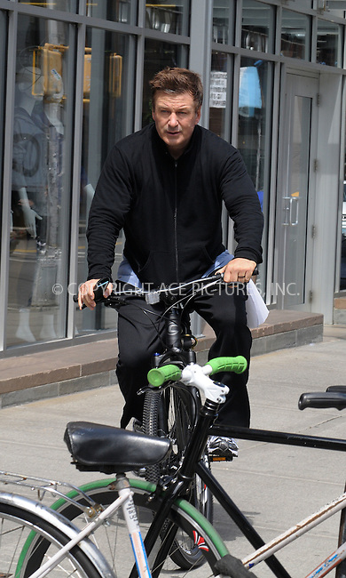 WWW.ACEPIXS.COM . . . . .  ....April 25 2012, New York City....Actor Alec Baldwin leaves a Manhattan gym on his bicycle on April 25 2012 in New York City....Please byline: CURTIS MEANS - ACE PICTURES.... *** ***..Ace Pictures, Inc:  ..Philip Vaughan (212) 243-8787 or (646) 769 0430..e-mail: info@acepixs.com..web: http://www.acepixs.com