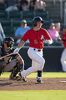 Michael Danner (2) of the Kannapolis Intimidators follows through on his swing against the Asheville Tourists at Intimidators Stadium on June 28, 2015 in Kannapolis, North Carolina.  The Tourists defeated the Intimidators 6-4.  (Brian Westerholt/Four Seam Images)