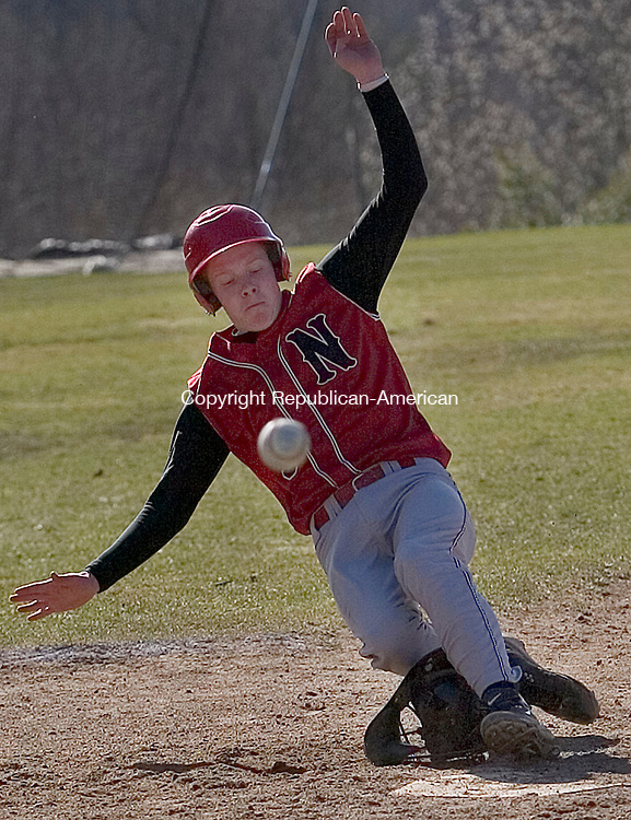 Winsted, CT-01 April 2007-041907MK07 Northwestern's #5 Drew Gordon slides into homeplate over the Thomaston's catcher mask during a wild throw in the Thursday afternoon baseball game at Northwestern Regional High School.  Northwestern held the lead for much of the game but had to make two runs int he bottom of the seventh to win 9-7.High School Thursday night.  The  Michael Kabelka Republican / American.(Northwestern's #5 Drew Gordon) CQ