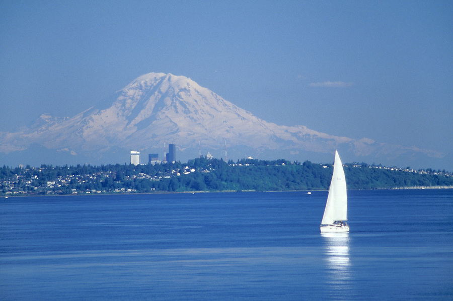 Sail boat on Puget Sound with Seattle and Mount Rainier in background, Washington