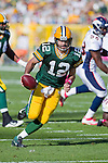 Green Bay Packers quarterback Aaron Rodgers (12) scrambles for a touchdown during a Week 4 NFL football game against the Denver Broncos on October 2, 2011 in Green Bay, Wisconsin. The Packers won 49-23. (AP Photo/David Stluka)