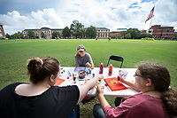 MSU students take a break from studying to participate in Art on the Drill, sponsored by the Department of Health Promotion and Wellness. The free event, held this week on the Drill Field, allows students to express their creativity and get to know fellow Bulldogs. Pictured, from left, are students Sydney Bishop, a freshman psychology major from Columbus, Alana Buchanan, a freshman biochemistry major from Olive Branch, and Melissa Schill, a junior communication major from Rindge, New Hampshire. <br />