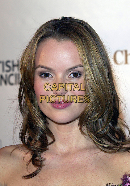AMANDA HOLDEN.'The Independent Film Awards'.Nominations announced today for the 8th Annual BRITISH INDEPENDENT FILM AWARDS to be held at Hammersmith Palais, London..London, United Kingdom.Ref: FIN.25th October 2005.portrait headshot plum lipgloss make-up brown corset style off the shoulder dress smiling posed.www.capitalpictures.com.sales@capitalpictures.com.© Capital Pictures.       .