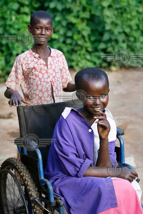 20 year old Florence Nizigiyimana lives in the Ruyigi Province with her mother, sister and brother. Their father left them five years ago. As a baby Florence was a normal child. Her mother says that at two months old Florence's legs and spinal column began to deform. Until recently she would just sit at the front of the house. A field worker with a community based rehabilitation program of Handicap International taught the family how they could take better care of Florence. They gave her better clothes, improved her personal hygiene and taught her some simple exercises. Now she has begun to walk with a stick. Although Florence has a wheelchair, she has never been to school. She will receive a tricycle soon, which will allow her to attend an educational centre for adults.