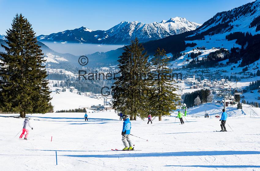 Austria, Vorarlberg, Kleinwalsertal, Hirschegg: ski run and village Riezlern at background with Allgaeu Alps and summit Nebelhorn | Oesterreich, Vorarlberg, Kleinwalsertal, Hirschegg: Skipiste, im Hintergrund Riezlern und das Nebelhorn