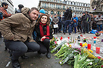 "BRUSSELS - BELGIUM - 23 March 2016 -- Belgium in mourning after the terrorist attack in  Maelbeek metro station - EU quarters, and the Brussels airport in Zaventem. -- Belgian couple Clement Amonea and Curray Volon brought flowers to the ""memorial"" at the Bourse in the city center. -- PHOTO: Juha ROININEN / EUP-IMAGES"