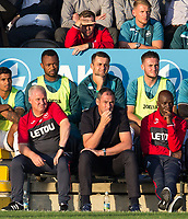 front row (l-r) Swansea City Assistant Coach Nigel Gibbs, Swansea City Manager Paul Clement, Swansea City Assistant Coach Claude Makelele during the 2017/18 Pre Season Friendly match between Barnet and Swansea City at The Hive, London, England on 12 July 2017. Photo by Andy Rowland.