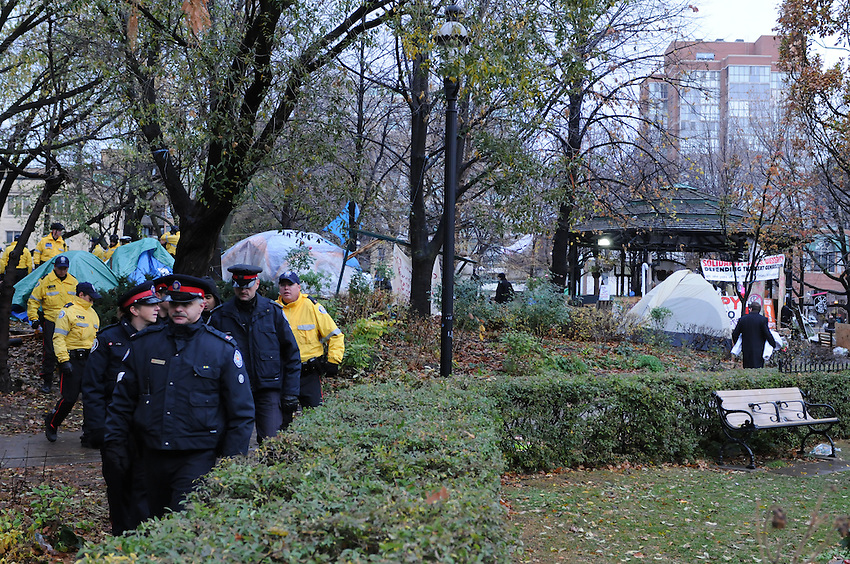 November 23, 2011, Toronto Police deployed in significant numbers early this morning to begin evicting the Occupy Toronto tent camp from St. James Park.  Here Police and city workers comb the site.