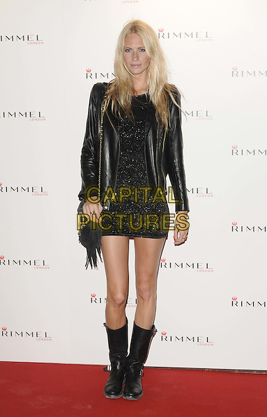POPPY DELEVIGNE .The Rimmel London party, Battersea Power Station, London, England..September 15th, 2011.full length black dress leather jacket boots bag purse .CAP/CAN.©Can Nguyen/Capital Pictures.