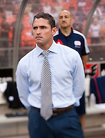 New England Revolution head coach Jay Heaps watches his team during a Major League Soccer game at RFK Stadium in Washington, DC.  New England defeated D.C. United, 2-1.
