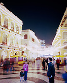 CHINA, Macau, Asia, The famous swirling black and white pavements of illuminated Largo do Senado square in central Macau
