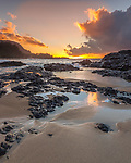 Kauai, H:I Sunset from Lumaha'i Beach with colors of the sky reflecting on the surf and sand beach