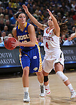 SIOUX FALLS, SD - MARCH 10: Kerri Young #10 from South Dakota State University passes the ball around the defense of Tia Hemiller #4 from the University of South Dakota in the first half of the Summit League Championship Tournament game Tuesday at the Denny Sanford Premier Center in Sioux Falls, SD. (Photo by Dick Carlson/Inertia)