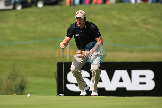Bradley Dredge (WAL) lines up his putt ont he 13th.during the first round of the Saab Wales Open at Celtic Manor 2010 course Newport, Wales. 2/6/11.Picture: Fran Caffrey/ www.golffile.ie .