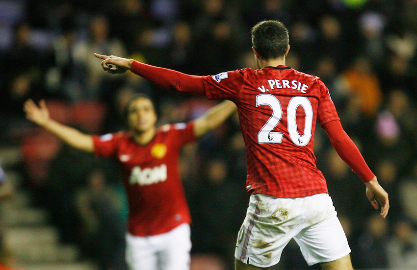 Manchester United's Robin van Persie celebrates scoring his sides fourth goal ..Football - Barclays Premiership - Wigan Athletic v Manchester United - Tuesday 1st January  2013 - DW Stadium - Wigan..