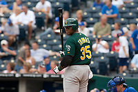 Oakland Athletics DH Frank Thomas gets a sign from third during the sixth inning at Kauffman Stadium in Kansas City, Missouri on August 18, 2006. The Royals won 7-1.