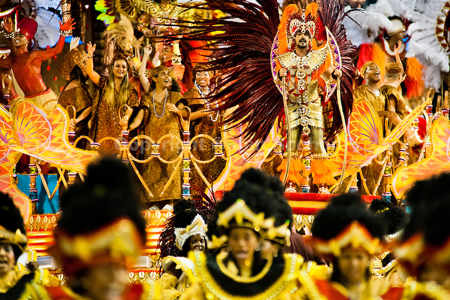 Dancers of Portela samba school perform during the Carnival parade at the Sambadrome in Rio de Janeiro, Brazil, 20 February 2012. The Carnival in Rio de Janeiro, considered the biggest carnival in the world, is a colorful, four day celebration, taking place every year forty days before Easter. The Samba school parades, featuring thousands of dancers, imaginative costumes and elaborate floats, are held on the Sambadrome, a purpose-built stadium in downtown Rio. According to costumes, flow, theme, band music quality and performance, a single school is declared the winner of the competition.