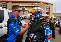 Jul 21, 2017; Morrison, CO, USA; Crew member with NHRA funny car driver John Force during qualifying for the Mile High Nationals at Bandimere Speedway. Mandatory Credit: Mark J. Rebilas-USA TODAY Sports