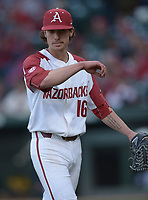 NWA Democrat-Gazette/ANDY SHUPE<br />Arkansas starter Blaine Knight returns to the dugout after recording the third Kent State out Friday, March 9, 2018, during the sixth inning at Baum Stadium in Fayetteville. Visit nwadg.com/photos to see more photographs from the game.