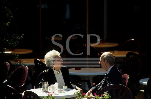 Buenos Aires, Argentina. Elderly couple drinking coffee at a cafe.