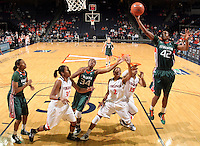 Jan. 6, 2011; Charlottesville, VA, USA; Miami Hurricanes guard Shenise Johnson (42) shoots the ball over Virginia Cavaliers defenders during the game at the John Paul Jones Arena. Miami won 82-73. Mandatory Credit: Andrew Shurtleff-