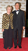 "Michael York and his wife, Pat, arrive at the Harry S. Truman Building (Department of State) in Washington, D.C. on December 4, 2004 for a dinner hosted by United States Secretary of State Colin Powell.  At the dinner six performing arts legends will receive the Kennedy Center Honors of 2004.  This is the 27th year that the honors have been bestowed on ""extraordinary individuals whose unique and abundant artistry has contributed significantly to the cultural life of our nation and the world"" said John F. Kennedy Center for the Performing Arts Chairman Stephen A. Schwarzman.  The award recipients are: actor, director, producer, and writer Warren Beatty; husband-and-wife actors, writers and producers Ossie Davis and Ruby Dee; singer and composer Elton John; soprano Joan Sutherland; and composer and conductor John Williams.<br /> Credit: Ron Sachs / CNP"