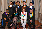 The recipients of the 41st Annual Kennedy Center Honors pose for a group photo following a dinner hosted by United States Deputy Secretary of State John J. Sullivan in their honor at the US Department of State in Washington, D.C. on Saturday, December 1, 2018.  From left to right back row: Thomas Kail, Lin-Manuel Miranda, Andy Blankenbuehler, and Alex Lacamoire.  Front row, left to right: Wayne Shorter, Cher, Reba McEntire, and Philip Glass The 2018 honorees are: singer and actress Cher; composer and pianist Philip Glass; Country music entertainer Reba McEntire; and jazz saxophonist and composer Wayne Shorter. This year, the co-creators of Hamilton,­ writer and actor Lin-Manuel Miranda; director Thomas Kail; choreographer Andy Blankenbuehler; and music director Alex Lacamoire will receive a unique Kennedy Center Honors as trailblazing creators of a transformative work that defies category.<br /> Credit: Ron Sachs / Pool via CNP