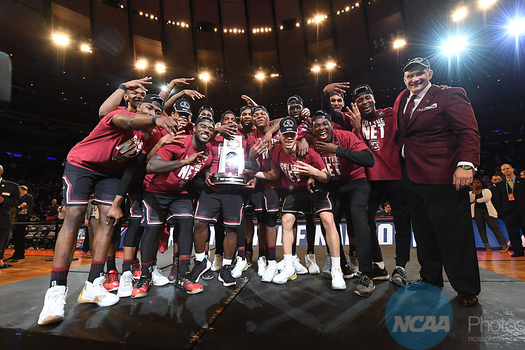 NEW YORK, NY - MARCH 26:  The South Carolina Gamecocks celebrate after winning the East Regional against the University of Florida during the 2017 NCAA Men's Basketball Tournament held at Madison Square Garden on March 26, 2017 in New York City. (Photo by Justin Tafoya/NCAA Photos via Getty Images)