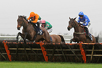 Race winner Winds And Waves ridden by Jake Greenall (3) in jumping action in the Connollys Red Mills Racehorse Cubes Handicap Chase