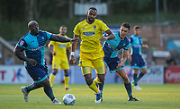 Adebayo Akinfenwa & Luke O'Nien of Wycombe Wanderers with Liam Trotter of AFC Wimbledon during the Friendly match between Wycombe Wanderers and AFC Wimbledon at Adams Park, High Wycombe, England on 25 July 2017. Photo by Andy Rowland.