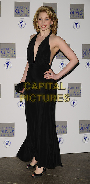 EMMA WILLIAMS.Laurence Olivier Awards at the Grosvenor House Hotel, Park Lane, London, England..March 8th 2009.full length black dress halterneck hand on hip.CAP/CAN.©Can Nguyen/Capital Pictures.