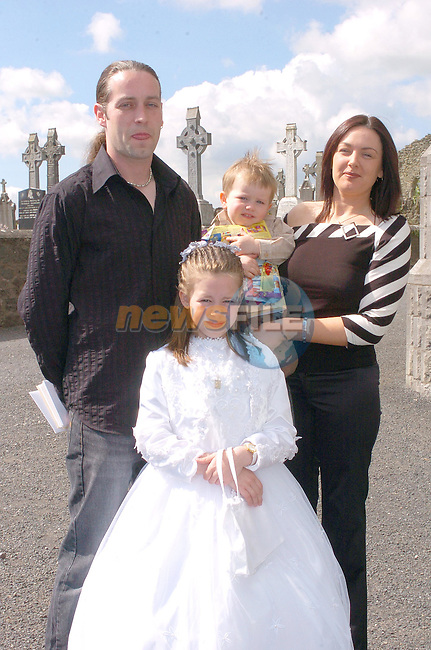 Chlow Walsh with her Brother evan and Parents Jackie and Brendan at First Communion in Tullyallen..Photo Fran Caffrey Newsfile.ie..This Picture has been sent to you by Newsfile Ltd..The Studio,.Millmount Abbey,.Drogheda,.Co. Meath,.Ireland..Tel: +353(0)41-9871240.Fax: +353(0)41-9871260.ISDN: +353(0)41-9871010.www.newsfile.ie..general email: pictures@newsfile.ie