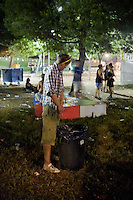 BENICÀSSIM, SPAIN - A drunk English festival goer pees in a dustbin at the Festival Internacional de Benicàssim...Described by some as a Mediterranean Glastonbury, the Festival Internacional de Benicàssim (FIB) is the largest music festival outside the UK to target British visitors. In 2010, seven of the eight main headline slots were filled by English bands...A small coastal town of 13,000 inhabitants, Benicàssim hosted some 200,000 visitors in 2009, with 40% of those believed to be coming from the UK. In 2010, attendances fell to 127,000 visitors but the percentage of UK visitors is believed to have risen.