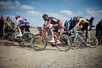 Zdenek Stybar (CZE/Etixx-QuickStep), Greg Van Avermaet (BEL/BMC) &amp; Sep Vanmarcke (BEL/LottoNL-Jumbo) cornering through sector 6B: Bourghelles &agrave; Wannehain<br /> <br /> 113th Paris-Roubaix 2015