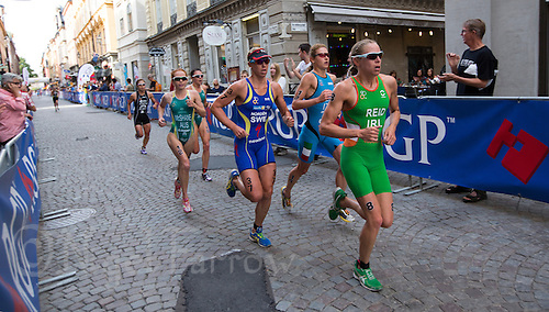 24 AUG 2013 - STOCKHOLM, SWE - Aileen Reid (IRL) (right) of Ireland runs through the streets of Gamla Stan the old part of Stockholm, Sweden during the elite women's ITU 2013 World Triathlon Series round (PHOTO COPYRIGHT © 2013 NIGEL FARROW, ALL RIGHTS RESERVED)