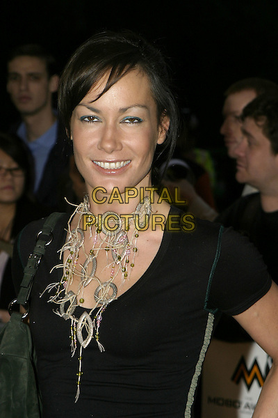 TARA PALMER TOMKINSON.MOBO Awards 2004 - Arrivals, Royal Albert Hall.September 30th, 2004.headshot, portrait, necklace, jewellery, blinking, funny face.www.capitalpictures.com.sales@capitalpictures.com.© Capital Pictures.