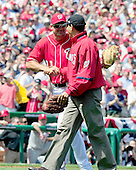 Washington, DC - April 5, 2010 -- United States President Barack Obama, right, shakes hands with Washington Nationals third baseman Ryan Zimmerman (11), left, after throwing out the first ball to open the 2010 Major League season in Washington, D.C. as the Philadelphia Phillies visit the Washington Nationals at Nationals Park on Monday, April 5, 2010.  Zimmerman caught the ceremonial first pitch..Credit: Ron Sachs / CNP