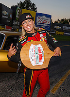 "Sep 2, 2016; Clermont, IN, USA; NHRA top fuel driver Leah Pritchett celebrates following her charity match race against ""Papa John"" Schnatter (not pictured), founder of Papa Johns Pizza prior to qualifying for the US Nationals at Lucas Oil Raceway. Papa John's and Don Schumacher Racing put up $10,000 each for Riley's Hospital for Children, adding $20,000 to funds already raised through pizza sales earlier in the day. Mandatory Credit: Mark J. Rebilas-USA TODAY Sports"