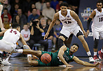 SIOUX FALLS, SD: MARCH 25:  Anthony Woods #20 of Northwest Missouri State falls while chasing a loose ball with D'Ondre Stockman #14 and Troy Cantrell #34 of Fairmont State during the Men's Division II Basketball Championship game on March 25, 2017 at the Denny Sanford Premier Center in Sioux Falls, SD. (Photo by Dick Carlson/Inertia)