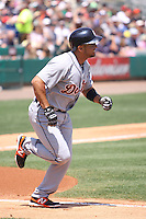 Detroit Tigers second baseman Omar Infante (4) hustles down the first base line against the Miami Marlins during a spring training game at the Roger Dean Complex in Jupiter, Florida on March 25, 2013. Detroit defeated Miami 6-3. (Stacy Jo Grant/Four Seam Images)........