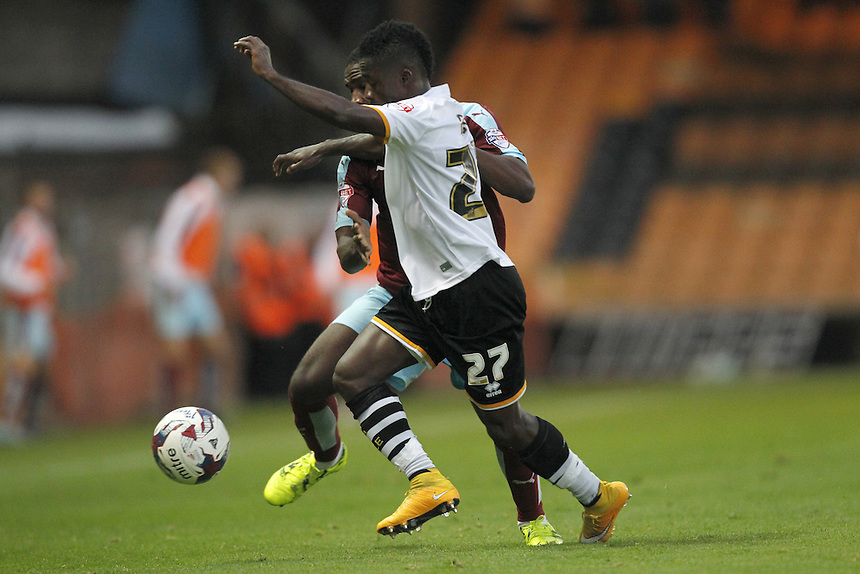 Burnley's Tendayi Darikwa battles with  Port Vale's Enoch Andoh<br />